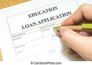 education loan application - Man filling out a education...