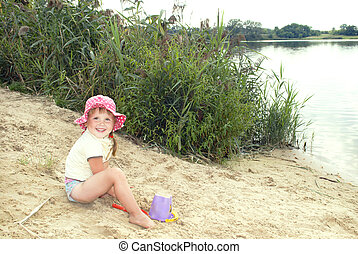 In the summer, the beach at the lake in the sand a little...