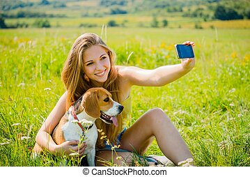 Dog and woman - happy life - Young woman taking photo of...