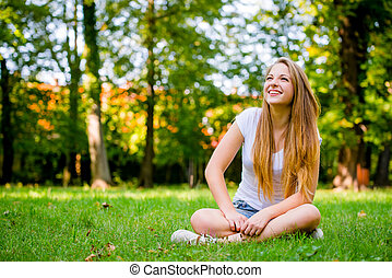 Young woman - happy in nature