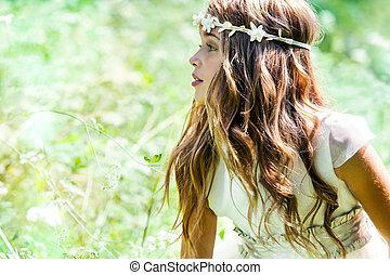 Cute girl wearing headband in field. - Close up portrait of...