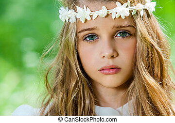 Face shot of cute girl with headband. - Extreme close up of...