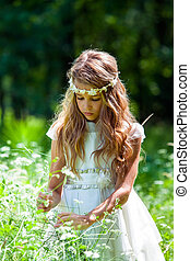 Girl in white dress picking flowers. - Close up portrait of...