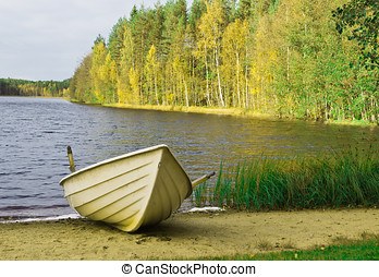 rowing boat - a rowing boat on the lake