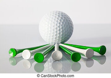 Golf equipments on the table - Different golf equipments on...