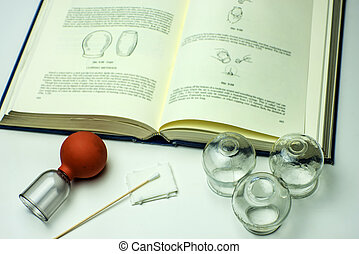 Cupping glasses with textbook