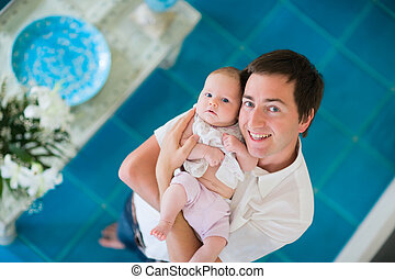 Happy fatherhood - Happy young father and his baby daughter...