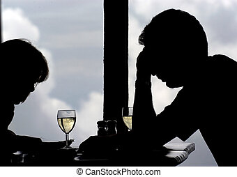 Tough talks - Man and woman in discussions over wine in the...