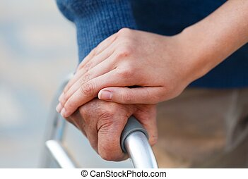Helping hand - Giving support to an old man, using the...