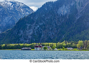 Koningsee lake and St. Bartholomew's Church, Germany -...