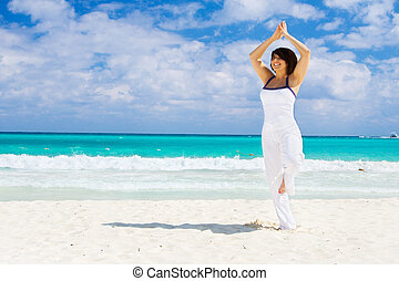 meditation of happy woman on the beach