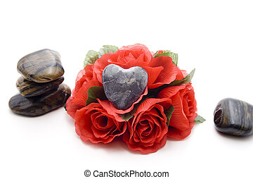 Heart stone with roses on white background