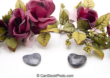 Stone heart with rose branch