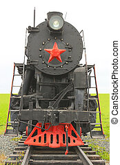 Old soviet locomotive, front view, on the background of...