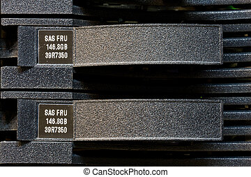 Row of hard drives mounted in a rack in a data center