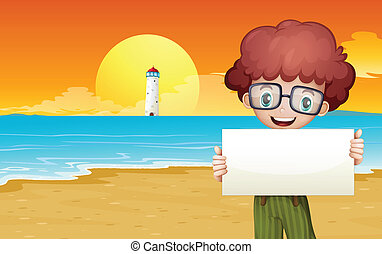 A boy at the beach holding an empty signage