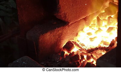 metal bars in a forge furnace - forge furnace with the metal...