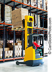 Pallet lifter - Yellow fork lifter with pallet in warehouse...