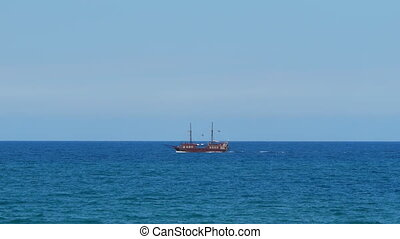 Pirate boat in the blue sea - Stylized piracy tourist...