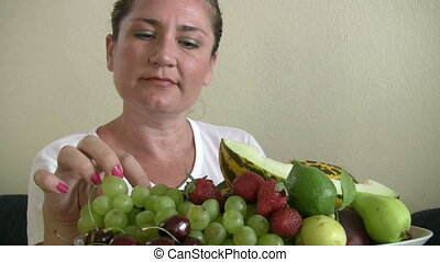 lots of fruits in the dish - Women showing lots of fruits in...