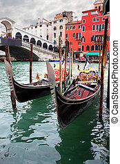 Gondolas near Rialto bridge in Venice, Italy