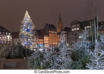 Christmas tree with decoration in the city square among...