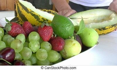 Dividing melon - Women Dividing melon