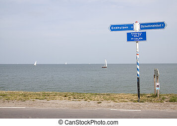 coast of the Lake ' Markermeer - town sign along the coast...