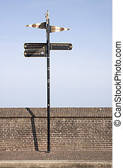 Direction sign on the quay wall in Enkhuizen
