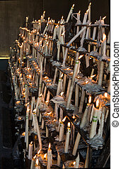 Flames stands - Candles at Votive sanctuary close to the...