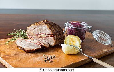 Spit roast with red cabbage and dumplings