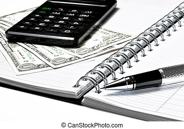 calculator, dollars and business pen on notebook on white...