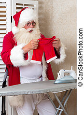 Santa with a laundry problem - Funny Santa Claus ironing his...