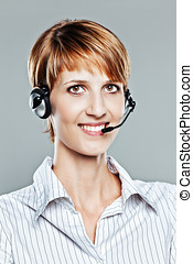 Female callcenter operator isolated on grey
