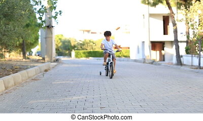 bicycle - little child ride bicycles and showing OK sing