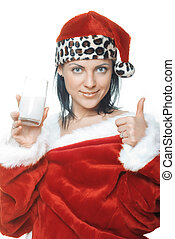 Santa with milk - Woman in Santa Claus costume holding glass...