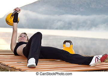 Kettlebells with fitness model - Fitness model posing and...