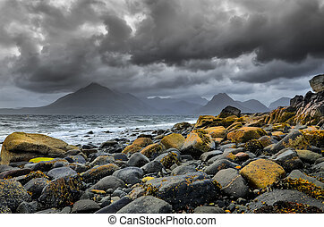 Landscape coastline view of rocks and Cullin hills,...