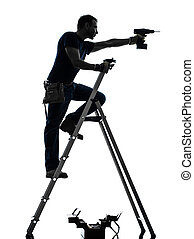 manual worker man on stepladder drilling silhouette - one...