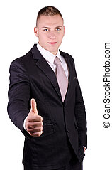 Businessman smiling with all right gesture in studio.