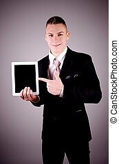 Businessman holding a tablet pc.