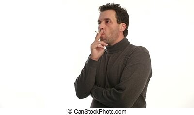 Mature man in his forties smoking a cigarette. Shot on white...
