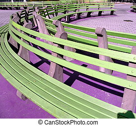 green benches - a park in Manhattan with curved green...