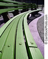 green park benches - some curved green park benches