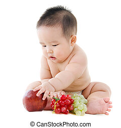 Baby boy with fruits