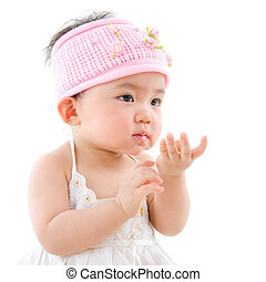 Asian baby girl eating - Portrait of cute Asian baby girl...