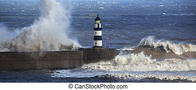 Waves crashing over Seaham Lighthouse on the northeast coast...