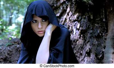 Woman with hood hiding - Beautiful woman scared in fantasy...