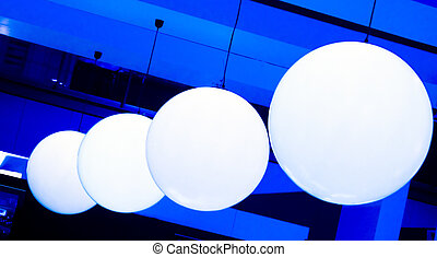 White Balls On Blue Background