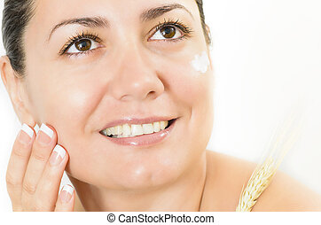 Perfect Skin - Young woman portrait with cream and wheat